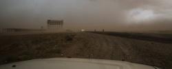 ABS IDP SETTLEMENT,  YEMEN -  6 MAY 2017.  A sandstorm barrels across the landscape near the sprawling ABS IDB settlement in Northeastern Yemen.