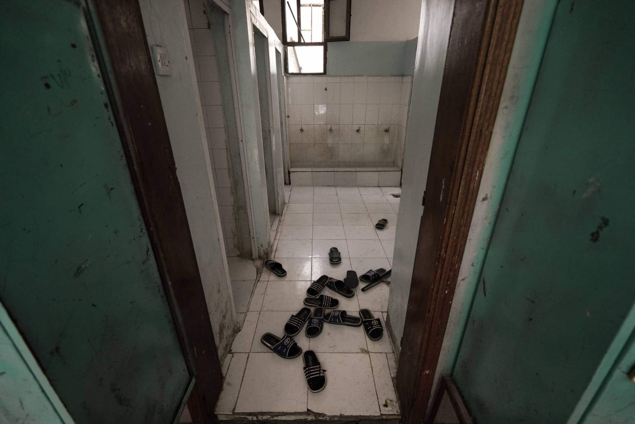 AL HUBAISHI ORPHANAGE, IBB CITY, YEMEN - 21 APRIL 2017.  The slippers of young orphans scattered on the floor of an orphanage in Ibb. The locally-run facility houses more than 200 boys, most of whose fathers were killed in action while serving in the army.   In many orphanages in Yemen, children have reportedly been targeted for recruitment by militants.