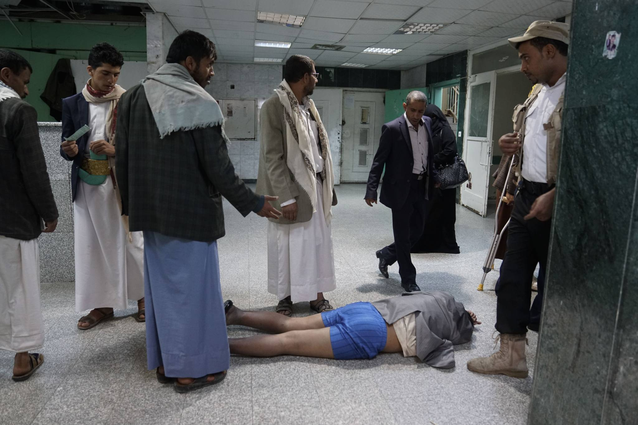 AL JOUMHOURI HOSPITAL, SANA'A, YEMEN - 3 MAY 2017.  A suspected cholera patient lies on the floor outside the emergency room, which has now been transformed into a cholera ward. A recent outbreak of cholera has swept over the city, following flooding and sewage overflow.   According to UNICEF figures, as of June 5th 2017, some 70,000 suspected cases of cholera had been reported in the past month alone. That number could quadruple to 300,000 cases by the start of July according to a recent statement by the regional director of UNICEF, Geert Cappelaere. The war is severely hampering access for critical medical supplies.