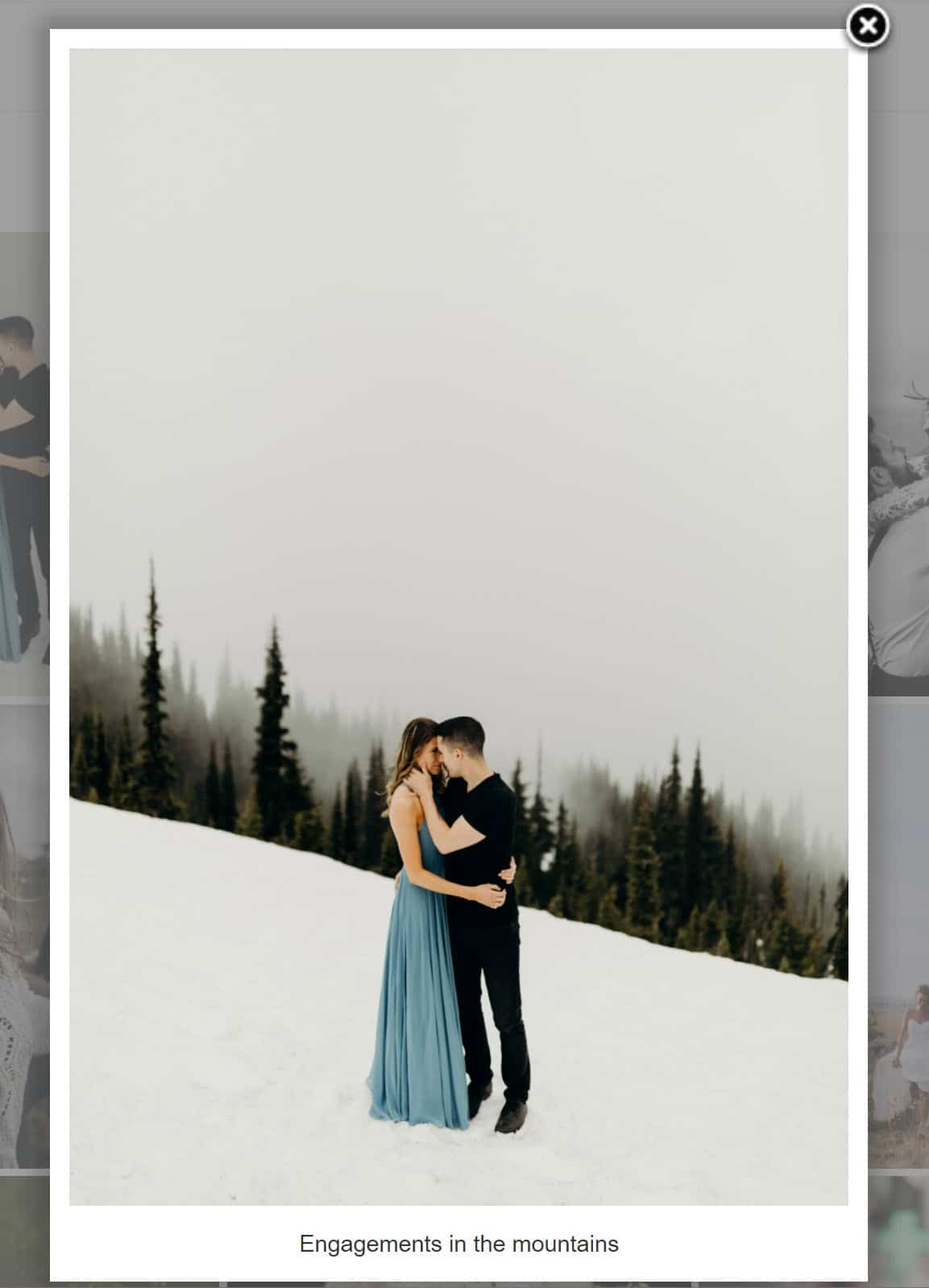 Screenshot of our Fancybox Lightbox Effect, a couple kissing in the snow