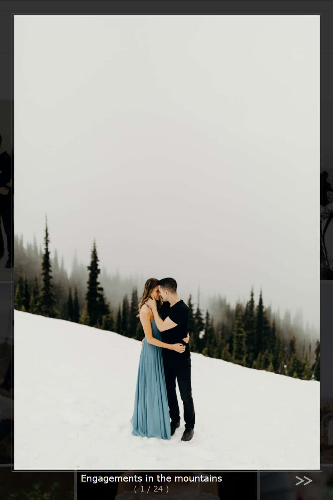 Screenshot of our Shutter Lightbox Effect, two people kising in the snow