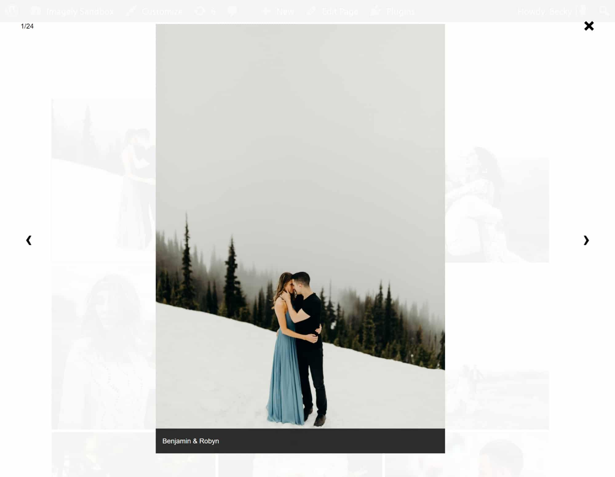 A screenshot of our Lightbox Effect showing the caption underneath, photo: a couple kissing in the snow