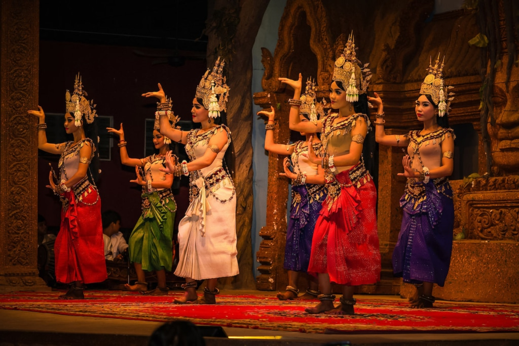 "In 1967, the queen's granddaughter Princess Norodom Buppha Devi, daughter of  King Norodom Sihanouk, performed the Apsara ballet in public. Buppha Devi combined two legends to create her ballet. The first part was from ancient Hindu texts that described the churning of the primordial ocean when the gods and demons searched for the elixir of Immortality called ""Amrit"". In the process, the spirits of water and clouds were released as heavenly nymphs or Apsaras. The Apsaras ascended to heaven to become dancers in the court of the Gods. The second part of the ballet was based on the Cambodian love story of king Kambu and the Apsara queen Mera. The ballet caught public imagination both in Cambodia and abroad. Princess Buppha Devi, who had started training for ballet dancing at the tender age of five, was an accomplished ballerina by then. She led the royal Cambodian dance troupe in many performances all over the world."
