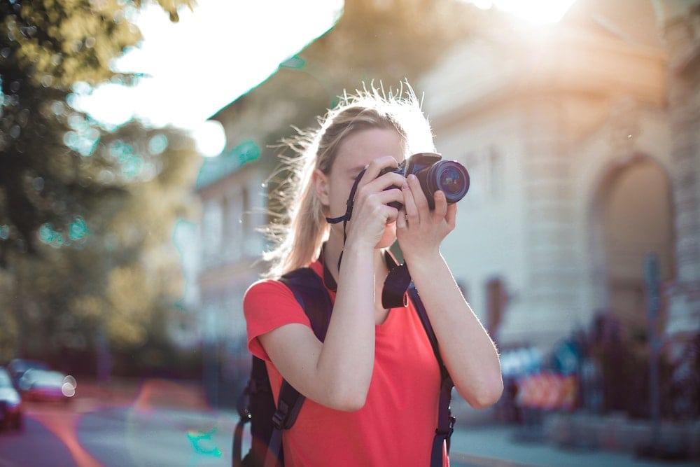A woman taking a photograph.
